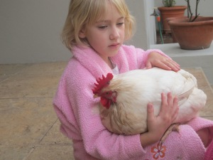 me when I was little, cuddling a rather large broiler